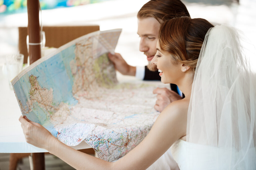 Happy married couple looking for a Honeymoon Destination